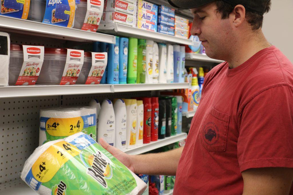 Man looking at groceries
