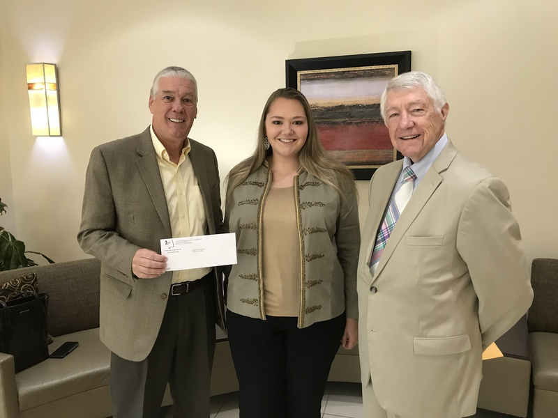 Elizabeth Peplinski pictured with her scholarship check