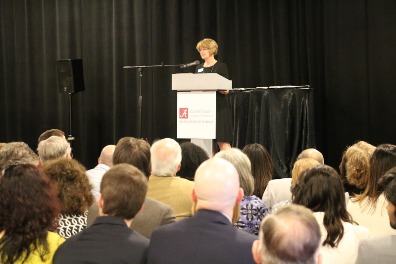 Dean Kay Palan addresses Culverhouse faculty and staff.