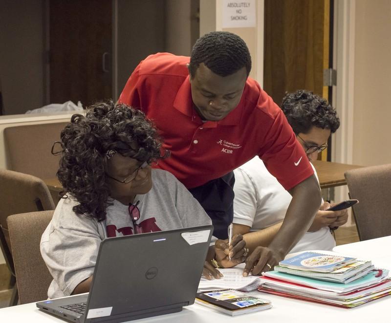 An ACIIR member assists members of the Tuscaloosa community.