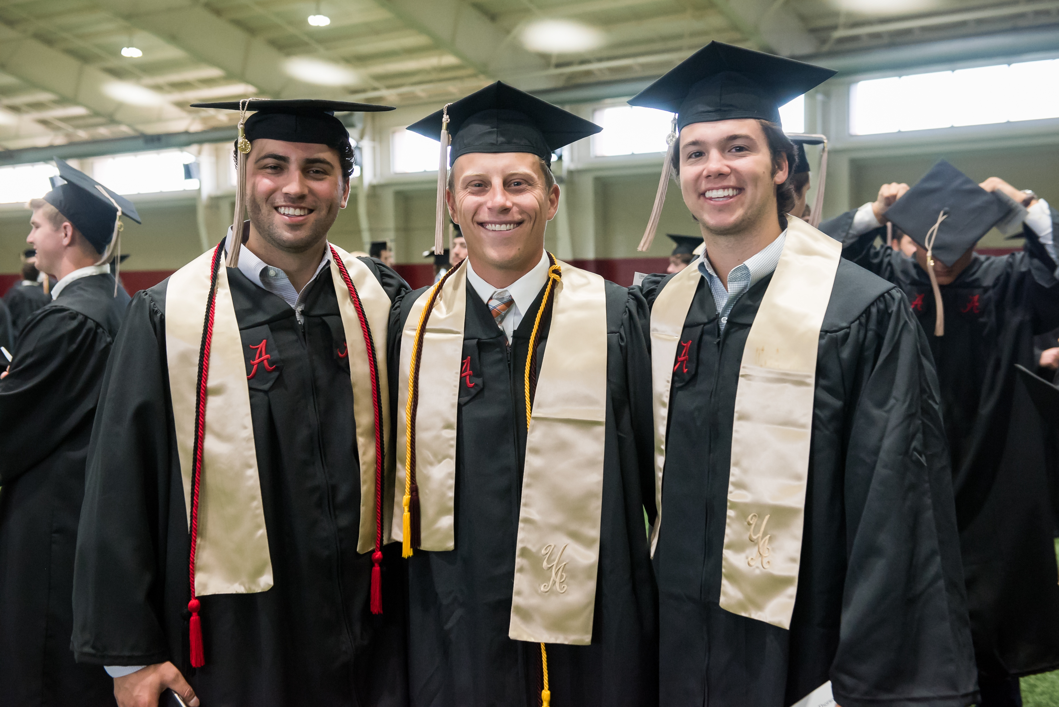 students pose for a picture at spring commencement
