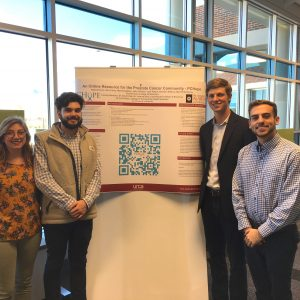 Students pose in front of their research project at the URCA conference