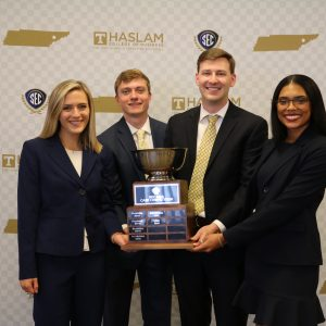 The Winning Manderson MBA Case team with their trophy.
