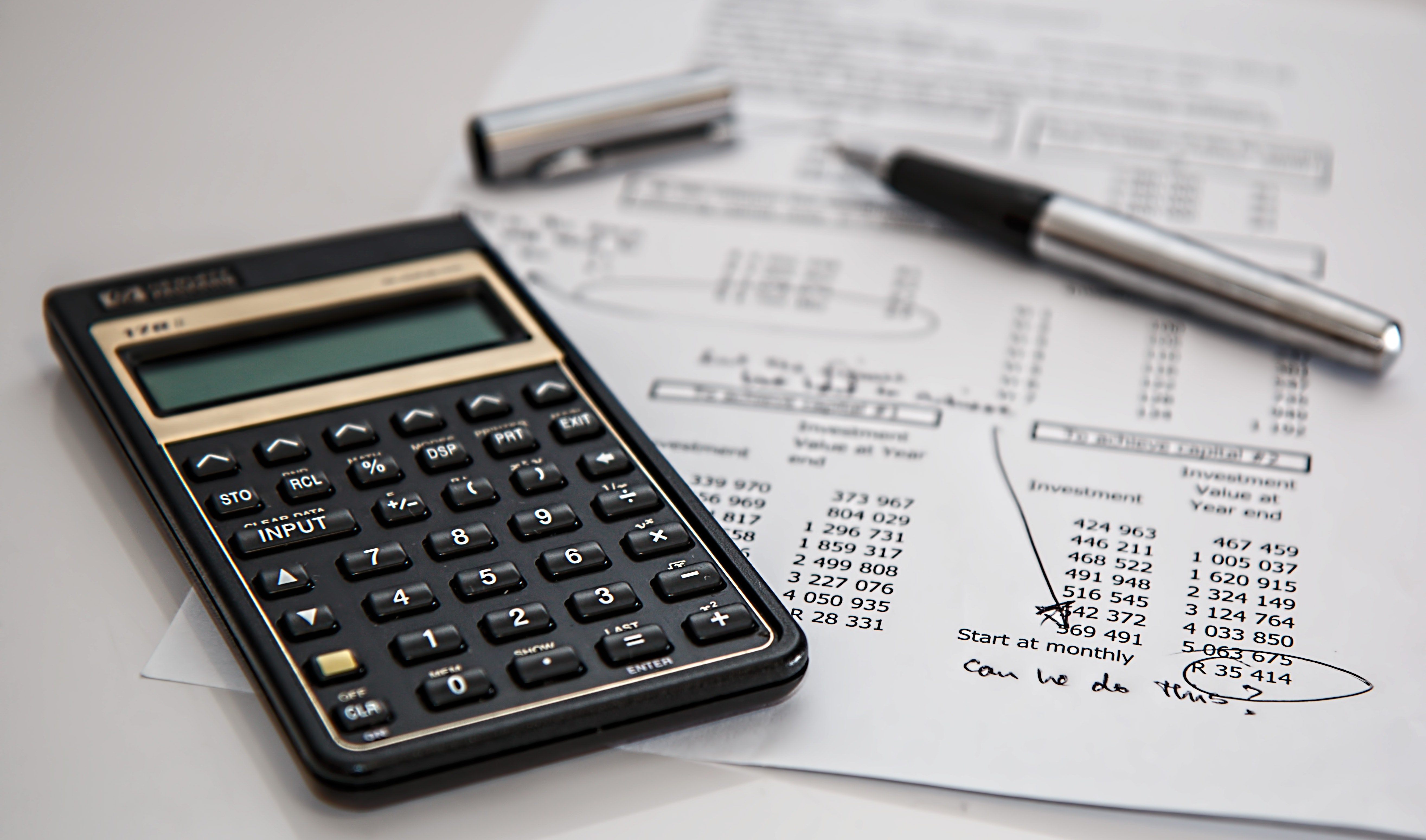 a calculator laid over financial documents