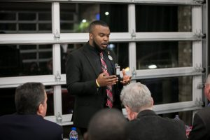 an entrepreneur pitching his idea at the River Pitch Competition