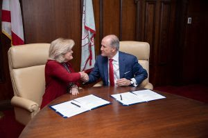 Jody Singer, left, director of NASA's Marshall Space Flight Center, and UA President Stuart R. Bell signed an agreement Nov. 6 on the UA campus.