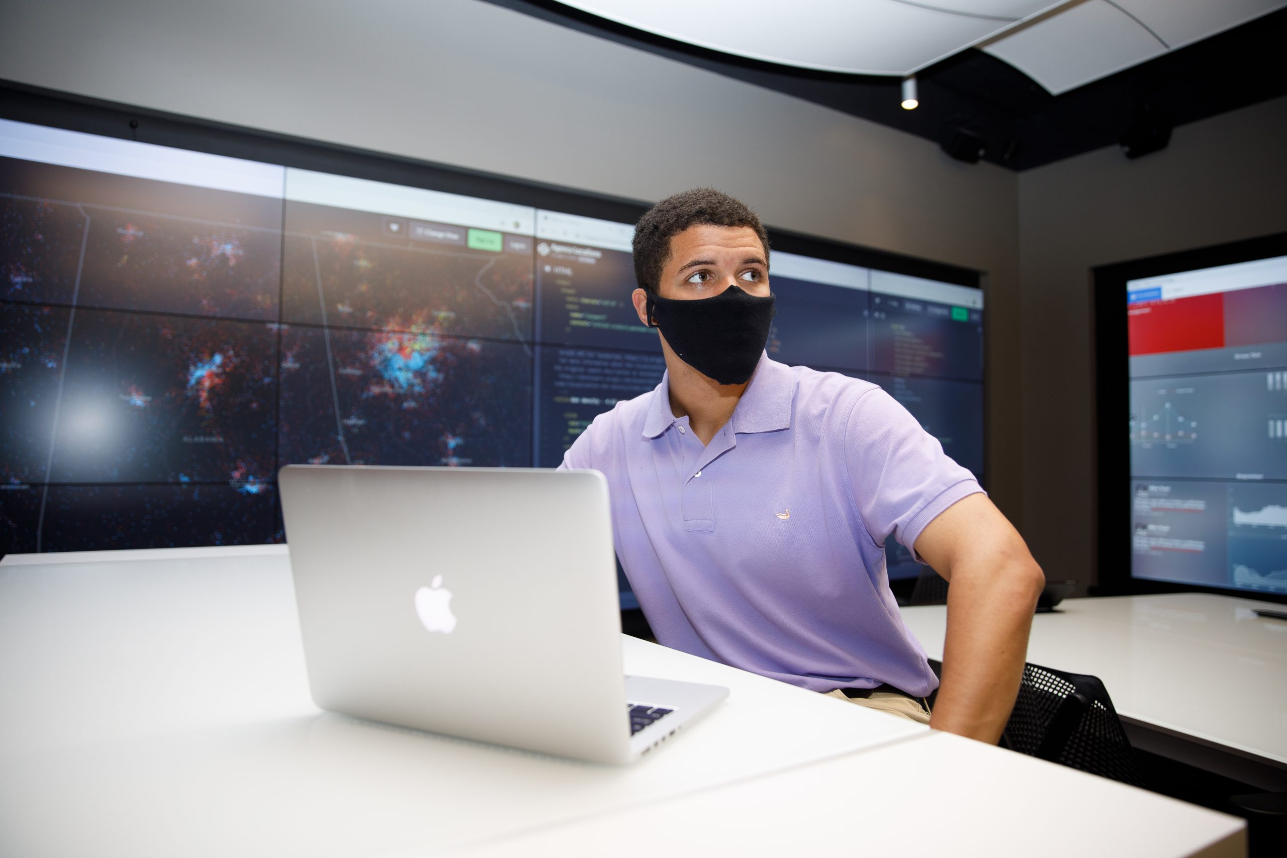 student in a mask at the data analytics lab