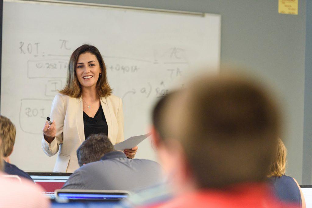 A Culverhouse professor teaching a class of students